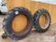 2 rear tractor tires on rims