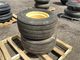 2 Firestone 31x13.50-15 tires with rims on pallet